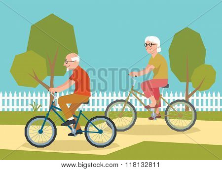 Mature Couple Riding On A Bicycle
