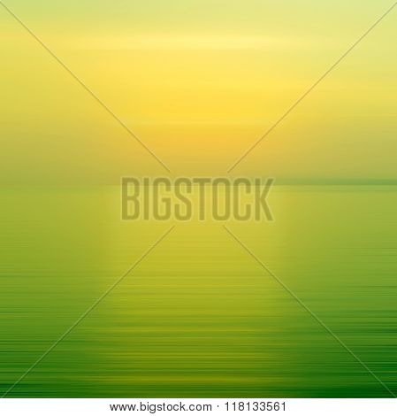 Abstract Yellow And Green Background Motion Blur Sunset On The Sea