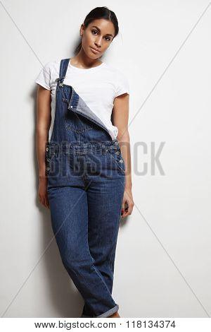 Woman Wears Denim Overals With Fallen Strap