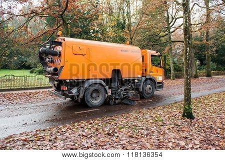 Orange Street Sweeper Machine Cleaning The Street