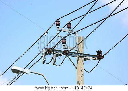 Close Up Of Power Line Insulators.