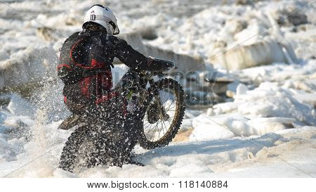 Enduro motorcycles are riding on rastasia ice on the river