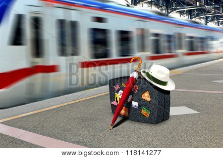 Retro Suitcase At Train Station Platform