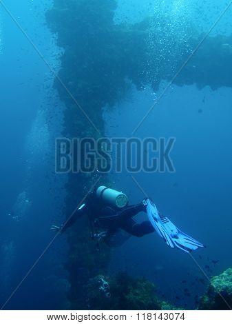 Scuba diving to ship wreck silhouette