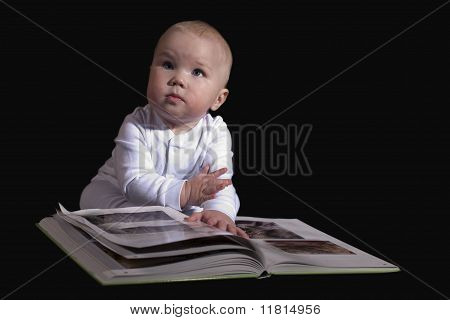 The Kid Sitting On The Floor And Read A Great Book