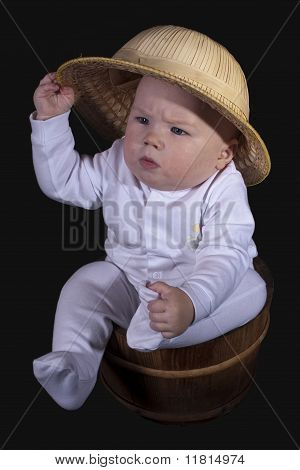 The Baby Sits In A Wooden Bucket