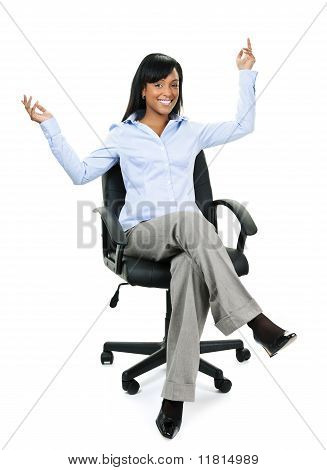Happy Businesswoman Sitting On Office Chair