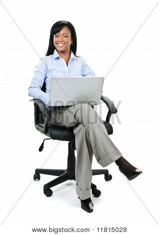 Businesswoman Sitting In Office Chair With Computer