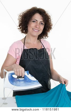 Closeup Of Woman Ironing Clothes On Ironing Board