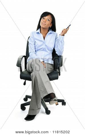 Thinking Businesswoman Sitting On Office Chair