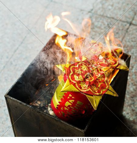 A custom in Chinese. People burn the Ghost Money and paper materials to honor the ancestor in festival so that their ancestor still can rich in heaven or hill.