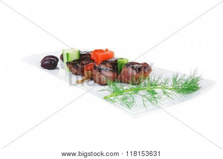 european food: roast beef meat goulash over white plate isolated on white background with vegetables