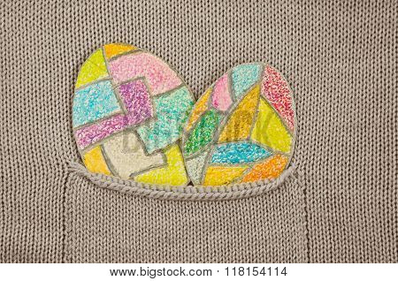 painted colorful Easter eggs in a knitted jacket pocket