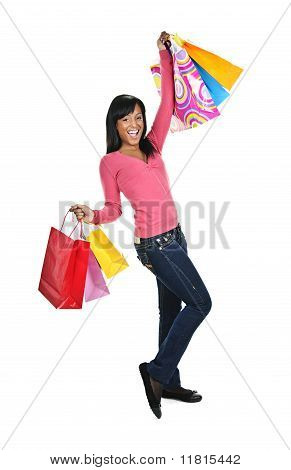 Excited Young Black Woman With Shopping Bags