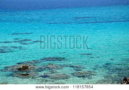 Turquoise Greek Sea And Snorkeler