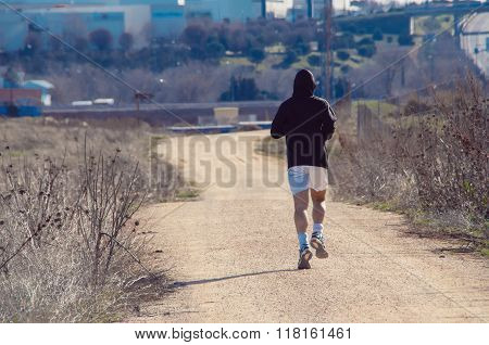 Back View Of Male Jogger
