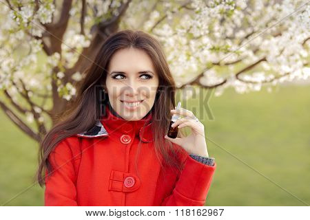 Smiling Woman with Respiratory Spray  in Spring Blooming Decor