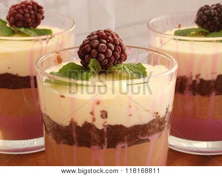 Verrine With Chocolate, Creamy Mousse, Berry Confit And Almond Biscuit