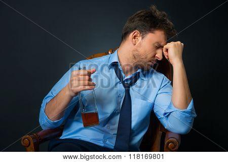 Drunk man drinking alcohol