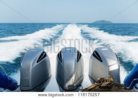 Three powerful engines mounted on the speedboat. Andaman Sea, Thailand.