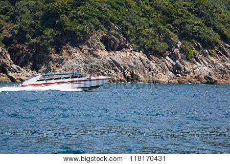 Cruise speed boat with tourists in the island in the Andaman Sea, Thailand