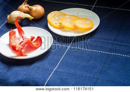 Red Peppers With Marinated Zucchini On A Blue Table. Frozen Pepper