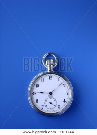 Pocket Watch On Blue Background With Copy Space