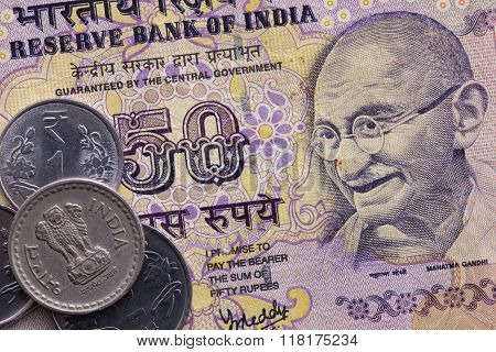 Different banknotes and coins of Indian Rupee