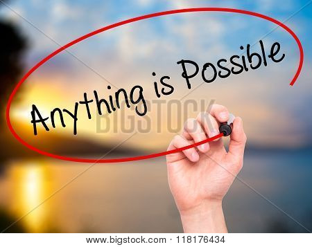 Man Hand Writing Anything Is Possible With Black Marker On Visual Screen