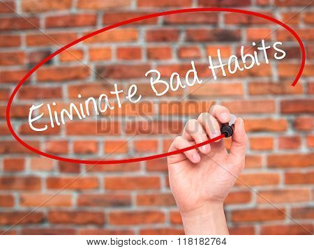 Man Hand Writing Eliminate Bad Habits With Black Marker On Visual Screen