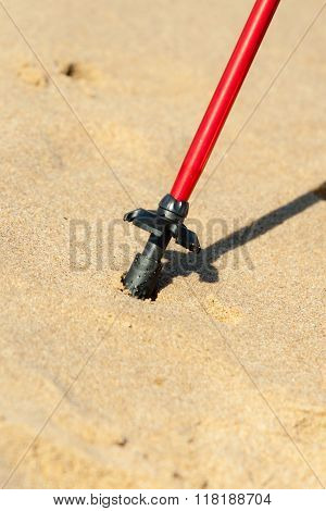 Nordic Walking. Red Stick On The Sandy Beach