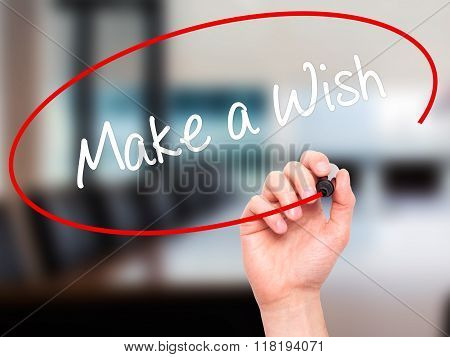Man Hand Writing Make A Wish  With Black Marker On Visual Screen