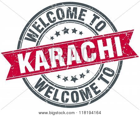 welcome to Karachi red round vintage stamp