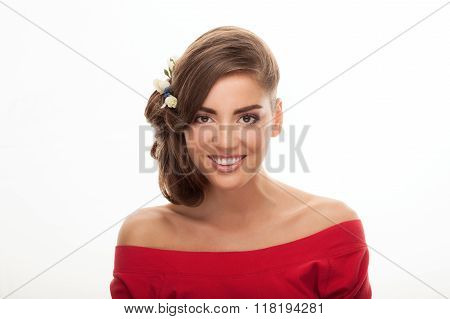 Closeup beauty portrait of young adorable brunette woman with nude makeup low bun hairstyle flower h