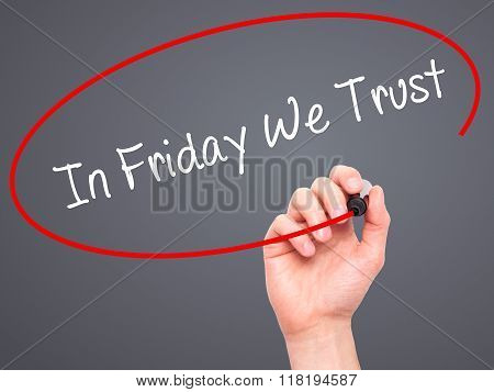 Man Hand Writing In Friday We Trust  With Black Marker On Visual Screen