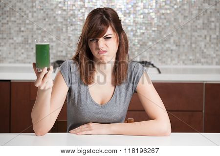 young woman don't want drink disgusting green diet drink