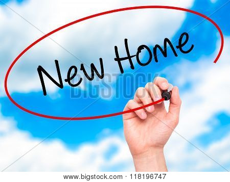 Man Hand Writing New Home  With Black Marker On Visual Screen