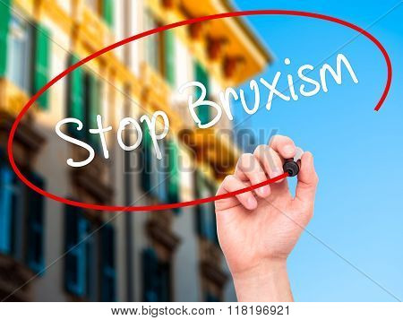 Man Hand Writing Stop Bruxism With Black Marker On Visual Screen