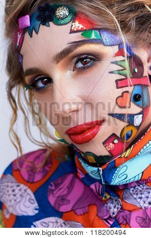Beautiful Woman With Bright Creative Fantasy Multicolored Makeup, Geometric Shapes.