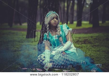 costume, alice in wonderland, girl in a forest with smoke colore and playing cards