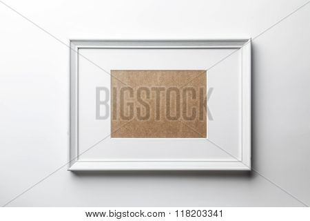 White wood frame on white wall