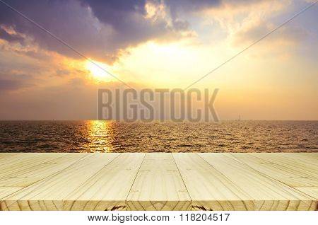 Outdoor Picnic Background With Wooden Table In The Evening Light.