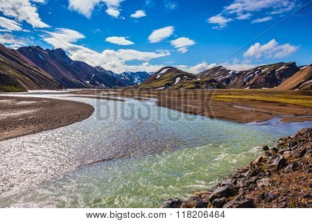 The picturesque valley in the national park Landmannalaugar, Iceland. Summer flood of meltwater flooded the road to a tourist camping