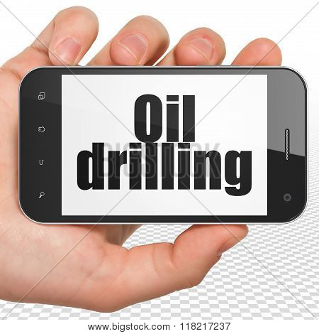 Industry concept: Hand Holding Smartphone with Oil Drilling on display