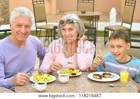 Grandparents with grandchild at breakfast