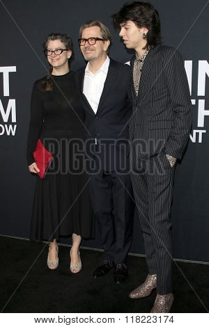 LOS ANGELES - FEB 10:  Alexandra Edenborough, Gary Oldman, Charlie Oldman at the SAINT LAURENT At The Palladium at the Hollywood Palladium on February 10, 2016 in Los Angeles, CA