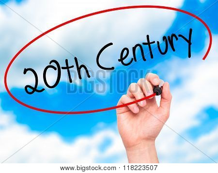 Man Hand Writing 20Th Century With Black Marker On Visual Screen