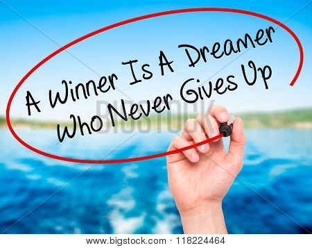 Man Hand Writing A Winner Is A Dreamer Who Never Gives Up With Black Marker On Visual Screen
