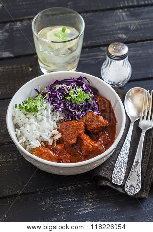 Beef Stew With Rice And Red Cabbage In A White Bowl On A Dark Wooden Background. Healthy Food