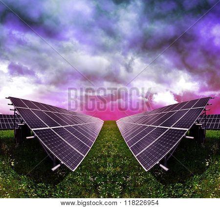 Solar energy panels against storm clouds.